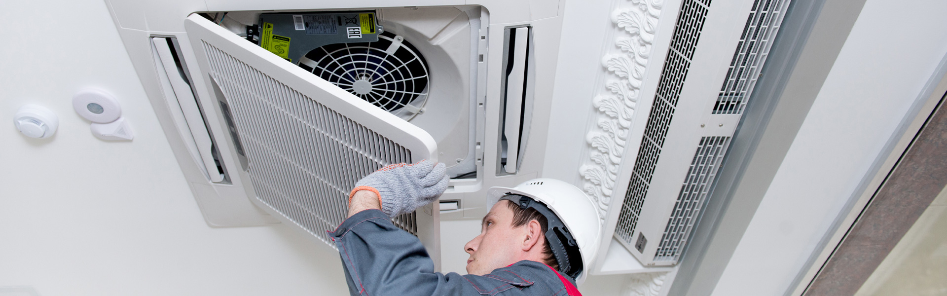 Engineer Completing Air Conditioning Maintenance & Servicing