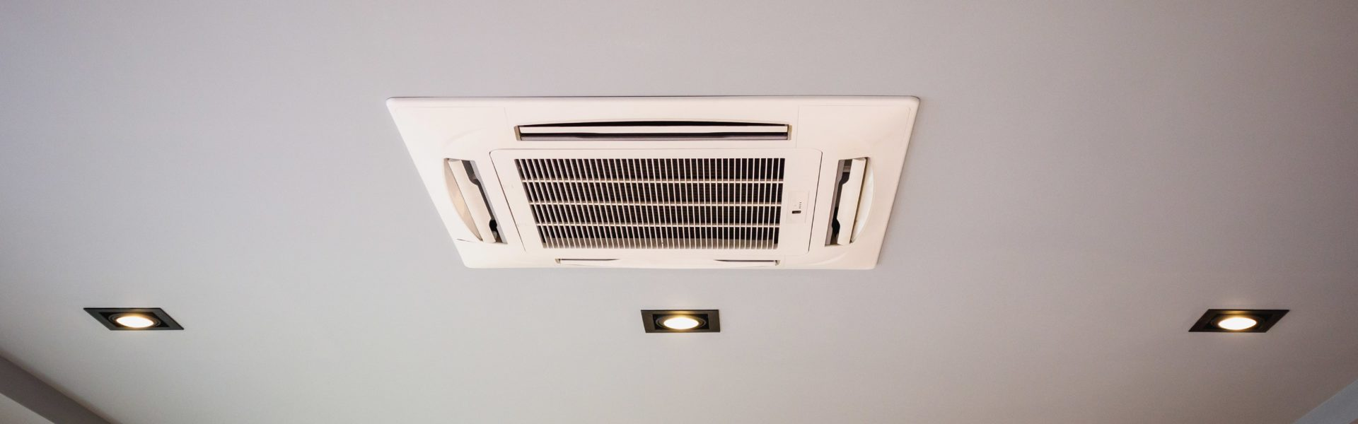 Air conditioning units along ceiling of building
